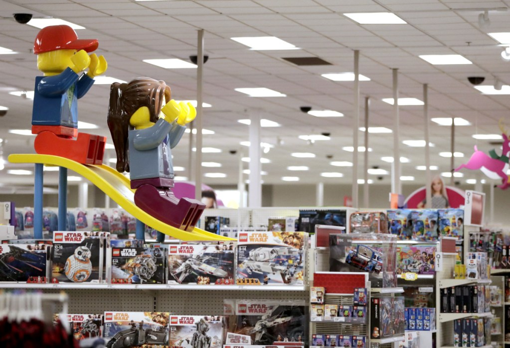 Two large Lego toys are displayed last week at a Target store in Bridgewater, N.J. Target's CEO estimates bankruptcies and closing have left $100 billion in market share up for grabs.