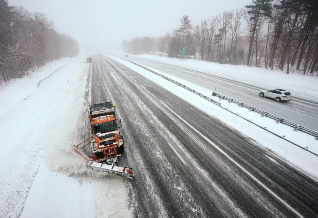A plow works a southbound lane of the Maine Turnpike in Kennebunk in March. So far, the Department of Transportation has been able to cover 21,200 miles of state roads by moving crews around and putting managers behind the wheel.