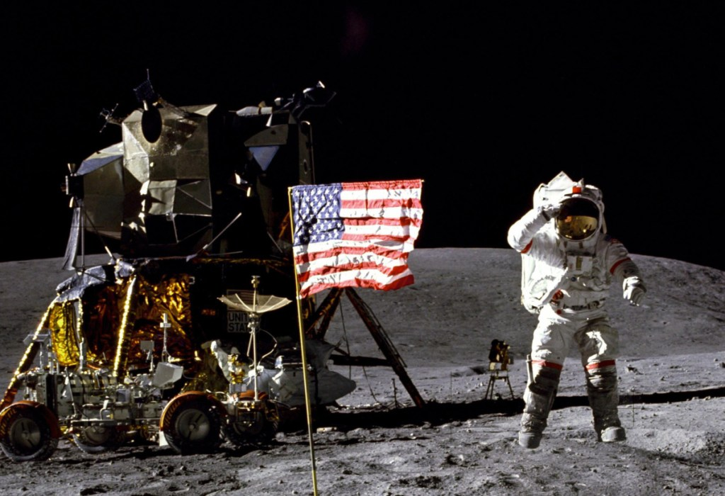 American astronaut John Young salutes the U.S. flag at the Descartes landing site on the moon during the first Apollo 16 extravehicular activity in April 1972.