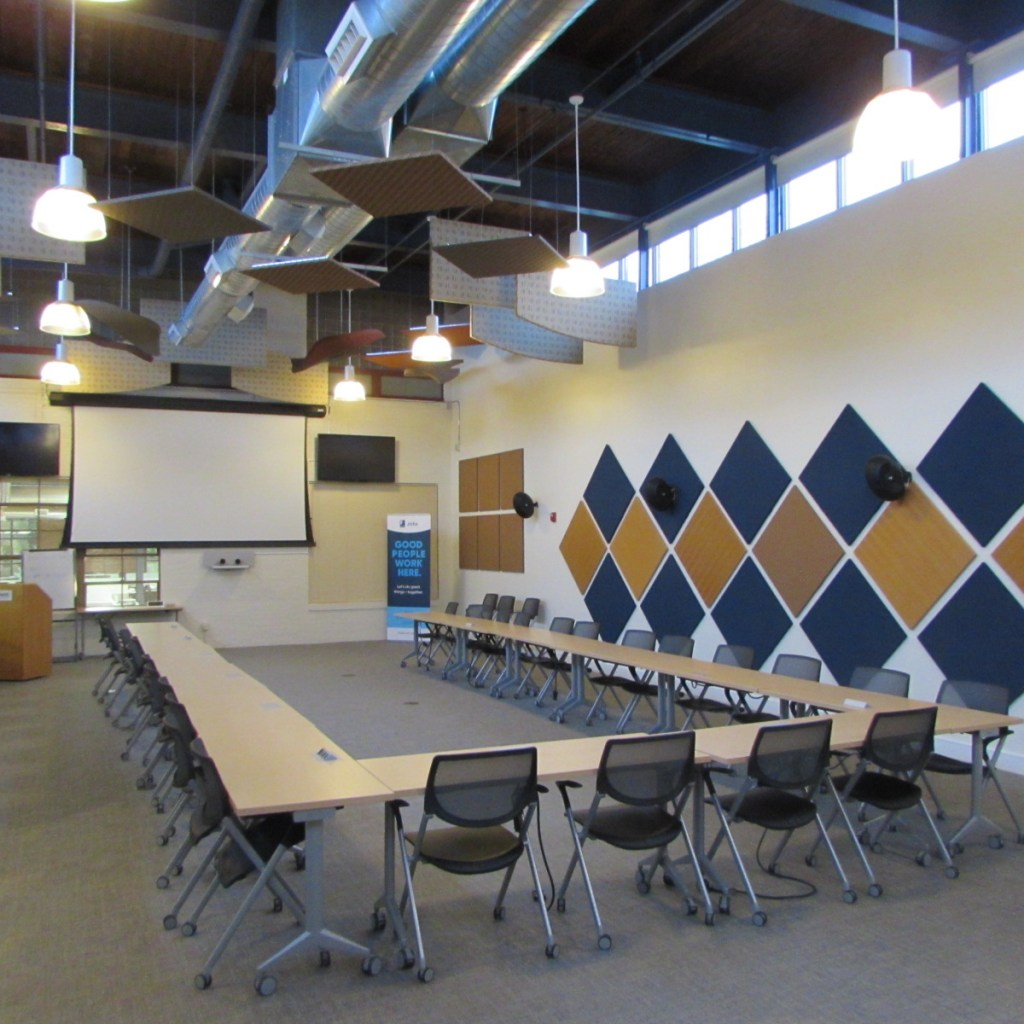 High ceilings and exposed beams in the unit's huge conference room.