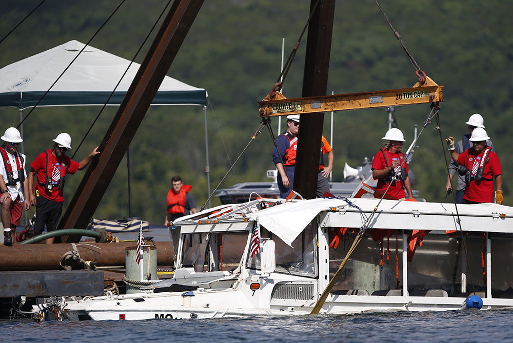 A duck boat that sank in Table Rock Lake in Branson, Mo., is raised after it went down the evening of July 19 after a thunderstorm generated near-hurricane strength winds, killing 17 people.