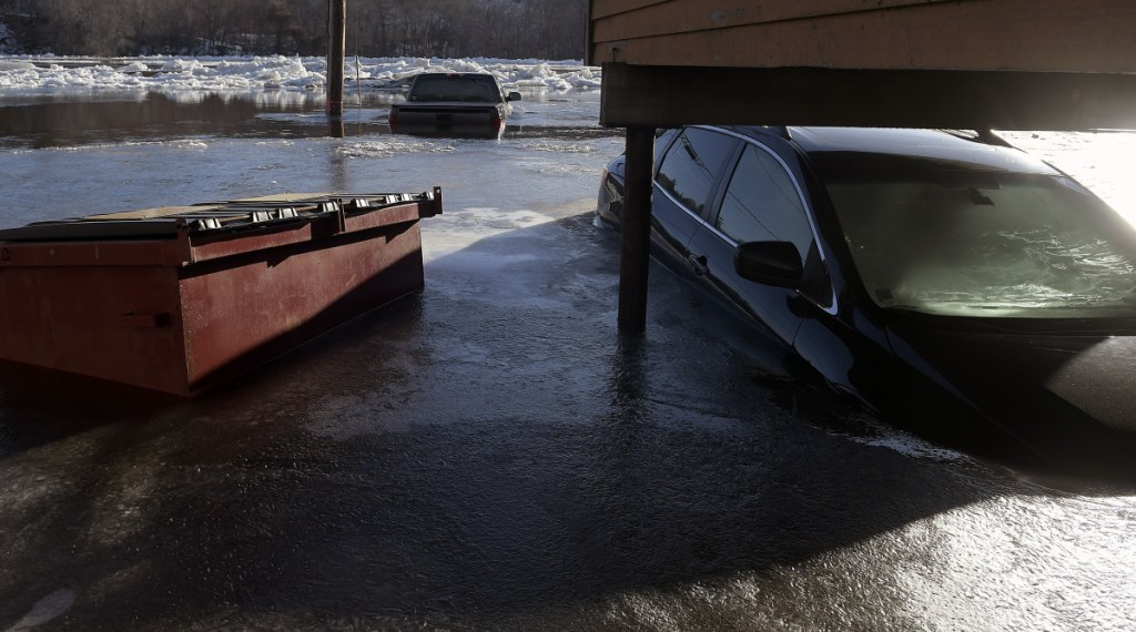 Cars stand submerged Jan. 14 in the Kennebec River in Hallowell after flooding in the early morning.