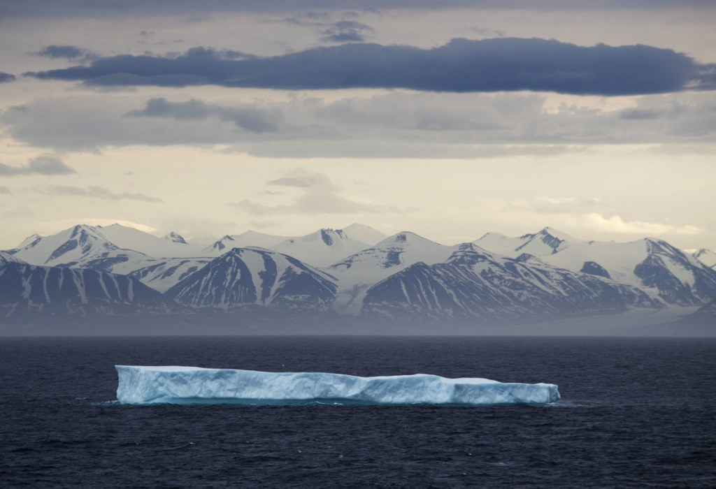 An iceberg in the Canadian Arctic Archipelago in July 2017. A recent National Oceanic and Atmospheric Administration report found record low winter sea ice the Arctic and increased toxic algal blooms.