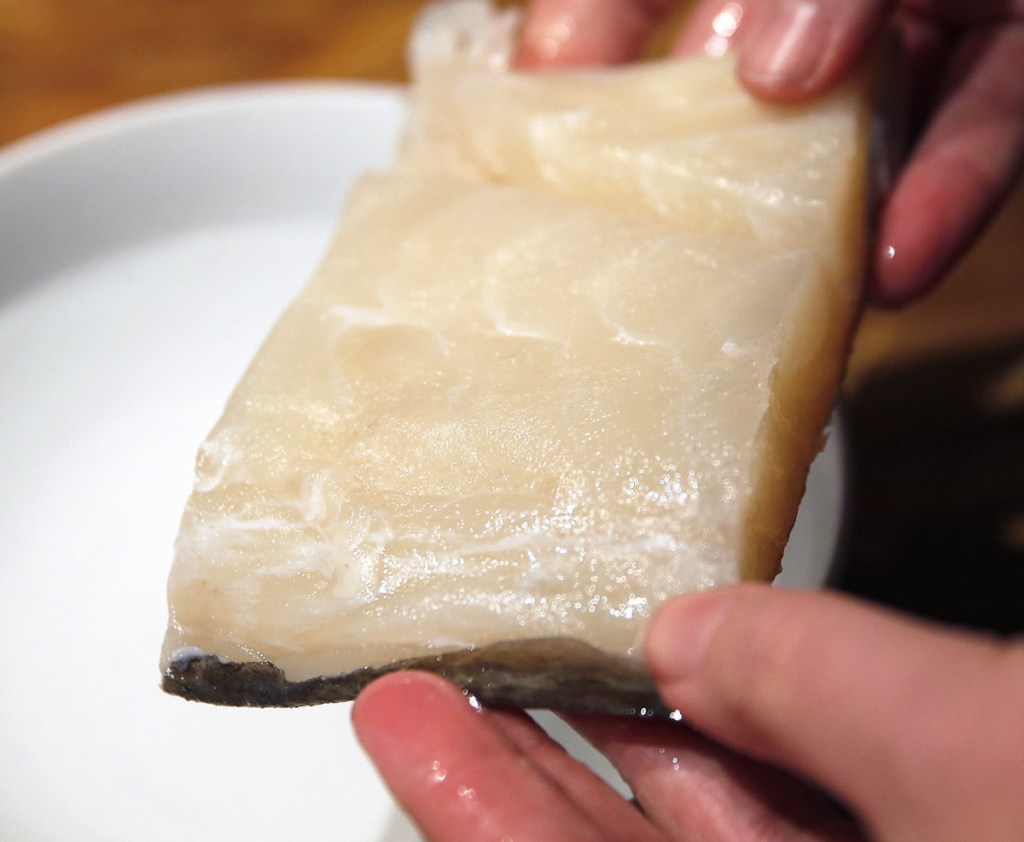 Salt cod is reconstituted in water before being simmered in milk.
