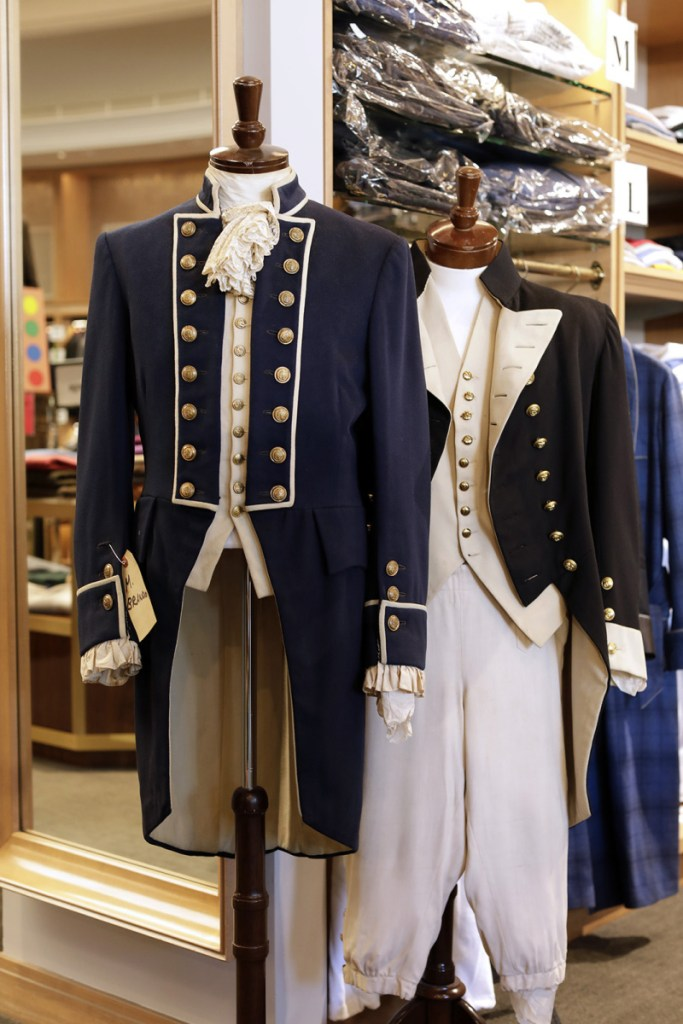 """Costumes from """"Mutiny on the Bounty,"""" Marlon Brando's 1962 outfit on the left and Charles Laughton's 1935 outfit on the right, are displayed at Carroll & Co. in Beverly Hills. The 70-year-old clothing store in Beverly Hills that has catered to celebrities and the affluent, will be shutting down early next year."""