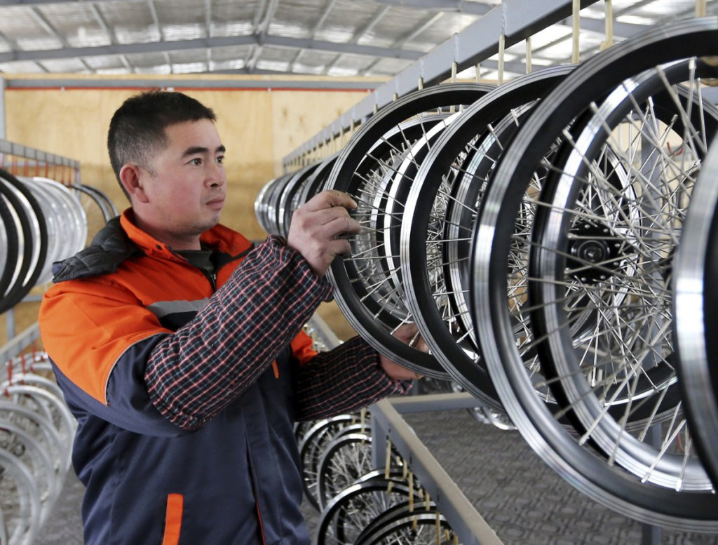 An employee works at a factory producing electronic bicycles for export in Huaibei. Both the U.S. and China have said they want to resolve trade differences, but progress has been slow.
