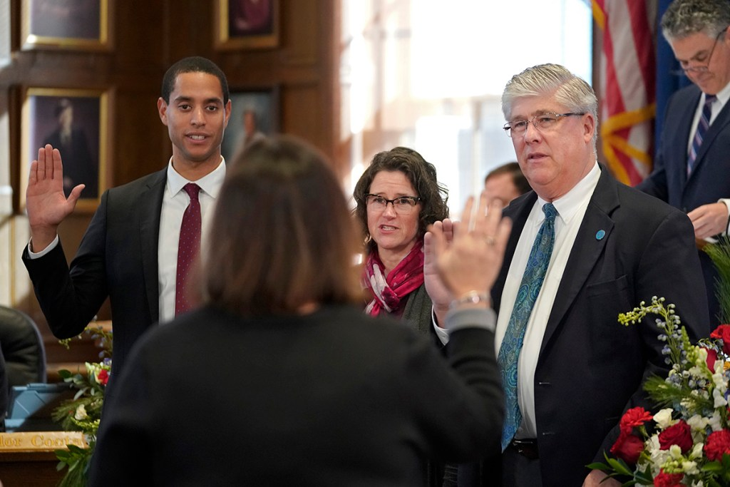 Councilors Spencer Thibodeau, Belinda Ray and Nicholas Mavodones Jr. are sworn in by City Clerk Katherine Jones on Monday at Portland City Hall.