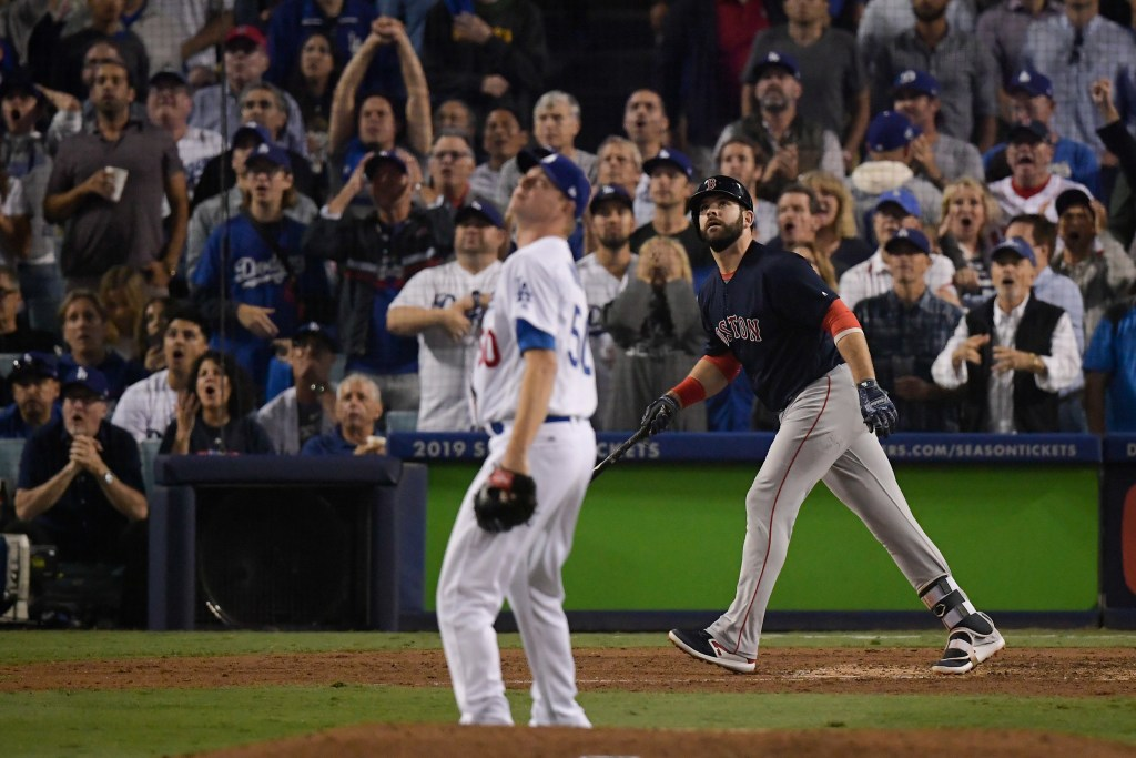 Boston Red Sox's Mitch Moreland watches his three-run home run off Los Angeles Dodgers relief pitcher Ryan Madson during the seventh inning in Game 4 of the World Series, which helped the Red Sox recover after losing Game 3 in the 18th inning.