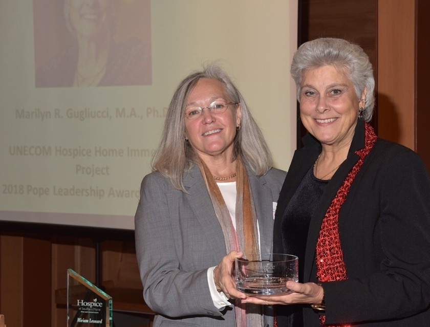 Dr. Katherine Pope, left, presented a leadership award recently from Hospice of Southern Maine to Marilyn Gugliucci, director of geriatrics education and research at the University of New England and its College of Osteopathic Medicine.