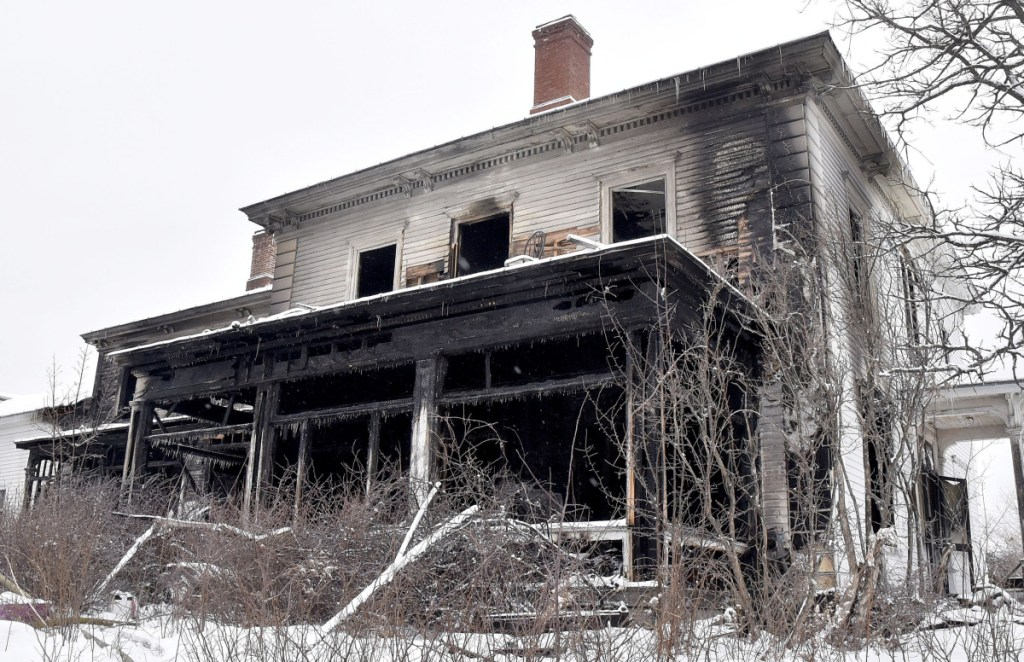 Fire damage mars the front of a large home at 46 Main St. in North Anson. The accidental blaze killed 63-year-old William Bloom on Thursday.
