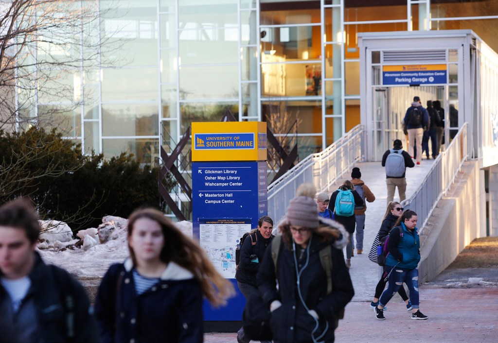 Students walk between buildings Monday on the University of Southern Maine's Portland campus. Trustees have approved a master plan that calls for new dorms, a new student center and a new campus quad in Portland.