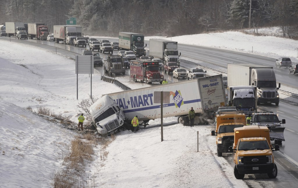 Traffic backs up as it is routed around a jackknifed tractor-trailer truck in the northbound lane of the Maine Turnpike in Biddeford on Jan. 3. Sagadahoc County Sheriff Joel Merry sees the danger in allowing much heavier single-trailer trucks and even longer trailers on their double-trailer trucks.