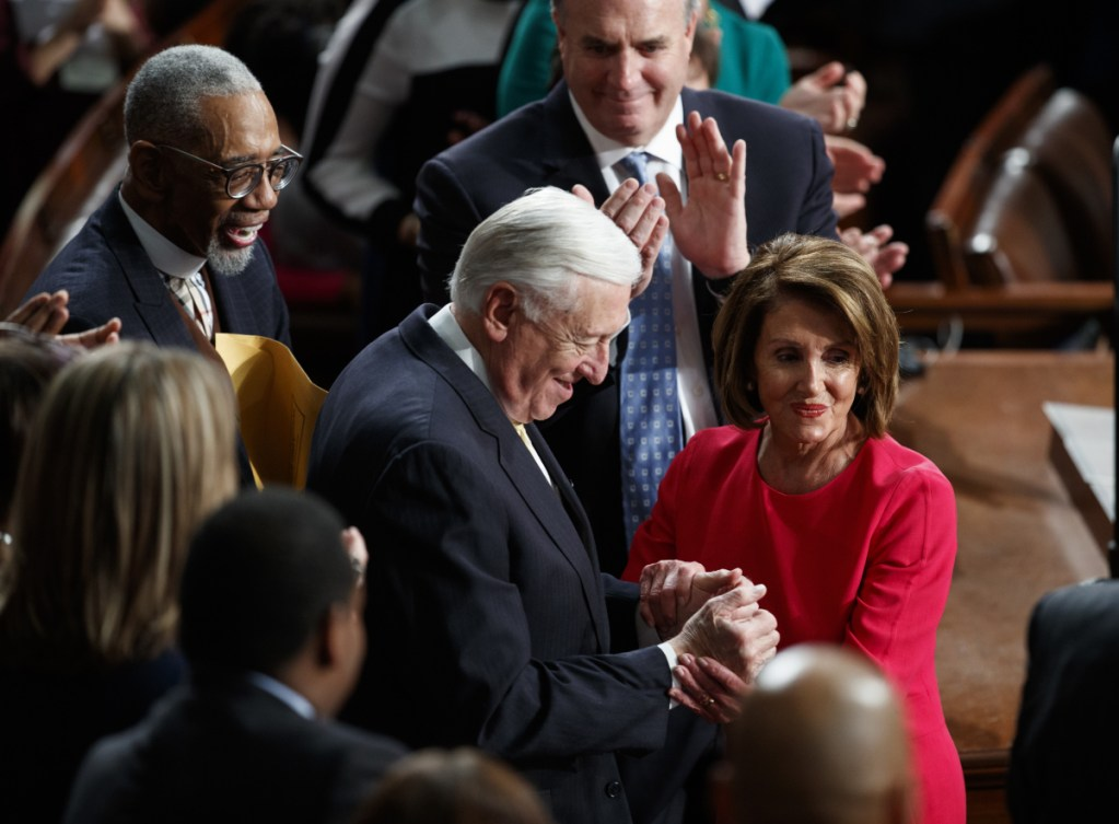 House Democratic Leader Nancy Pelosi of California, who is expected to lead the 116th Congress as speaker of the House, and House Minority Whip Steny Hoyer, D-Md., are applauded at the Capitol in Washington on Thursday.