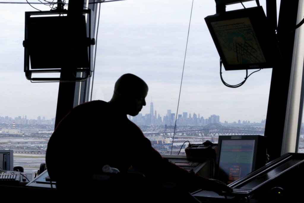 An air traffic controller works in the tower at Newark Liberty International Airport in Newark, N.J., in 2015.