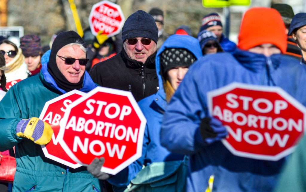 The annual Hands Around the Capitol demonstration brought together abortion critics, who face an uphill climb now that Democrats control the Legislature and Blaine House.