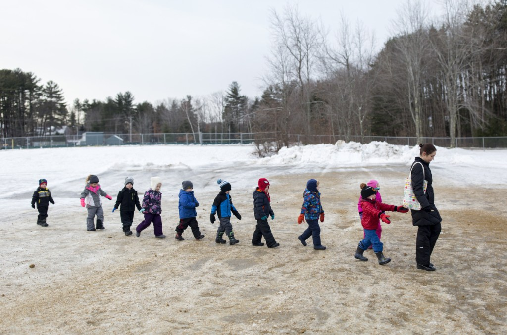 Pre-kindergarten teacher Melissa Wu walks her students back to class last week at John F. Kennedy Memorial School in Biddeford, which has one of the few districts in Maine that offer pre-K to all 4-year-olds who want to attend.