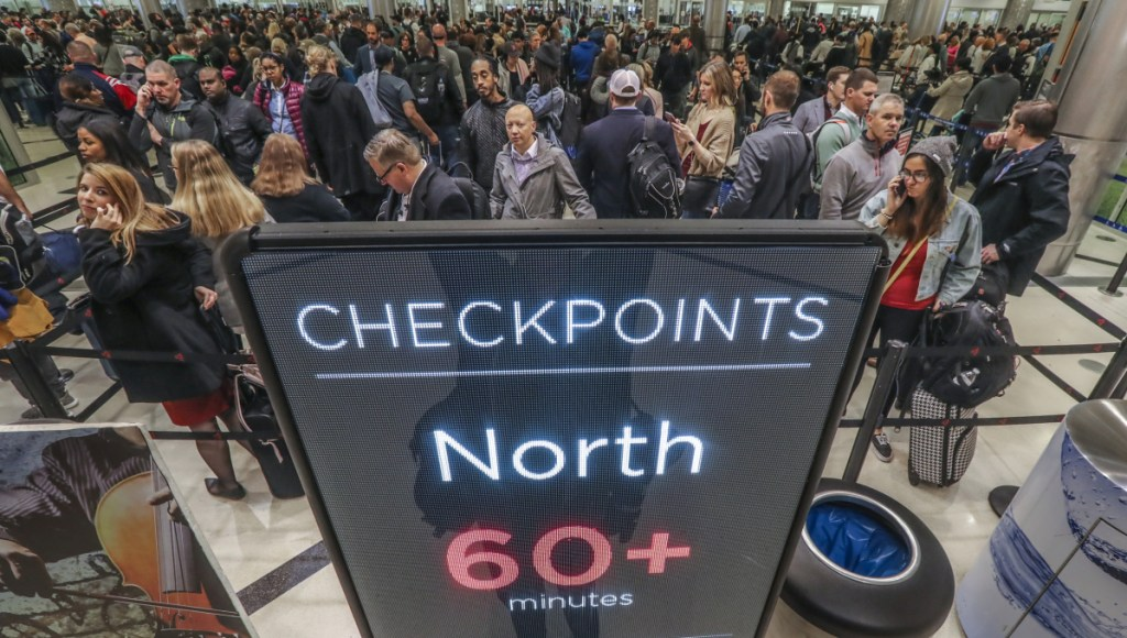 Security lines at Hartsfield-Jackson International Airport in Atlanta stretch more than an hour long amid the partial federal shutdown, causing some travelers to miss flights on Monday. The long lines signaled staffing shortages at security checkpoints, as TSA officers have been working without pay since the federal shutdown began Dec. 22.