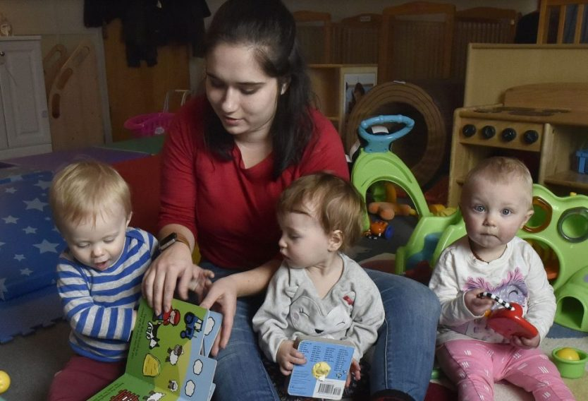 Children's Place assistant teacher Cassidy Brown reads aloud at the Maine Children's Home for Little Wanderers. The private nonprofit may soon have to cut the number of children it serves.