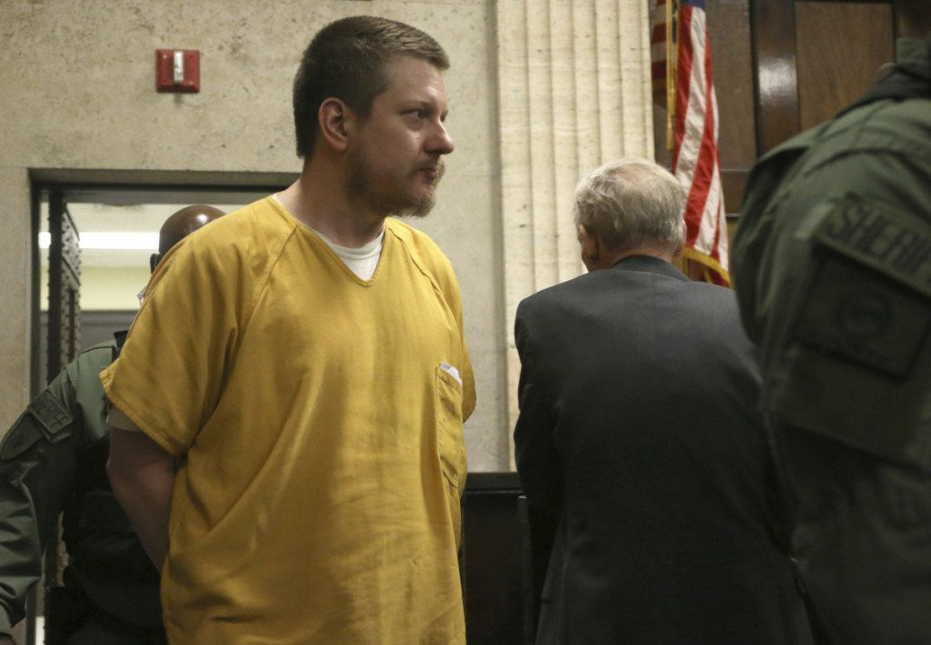 Former Chicago police Officer Jason Van Dyke is escorted into the courtroom for his sentencing hearing at the Leighton Criminal Court Building in Chicago on Friday, for the 2014 shooting of Laquan McDonald.