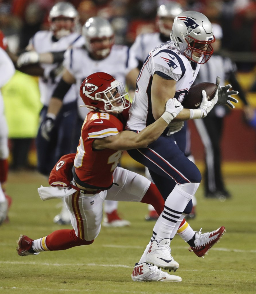 New England Patriots tight end Rob Gronkowski (87) makes a catch against Kansas City Chiefs defensive back Daniel Sorensen (49) during the first half of the AFC Championship NFL football game, Sunday, Jan. 20, 2019, in Kansas City, Mo. (AP Photo/Charlie Neibergall)