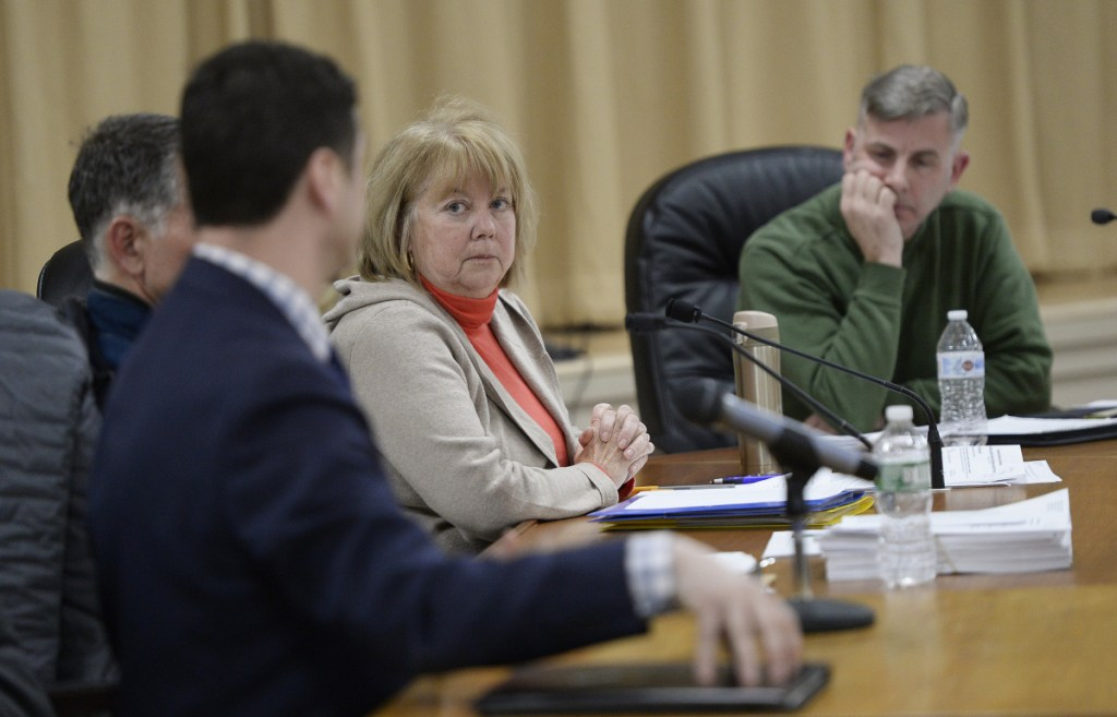 Madeline Mooney, listening to town attorney Philip Saucier at a meeting in January, is one of the Ogunquit Select Board members targeted by a recall petition.