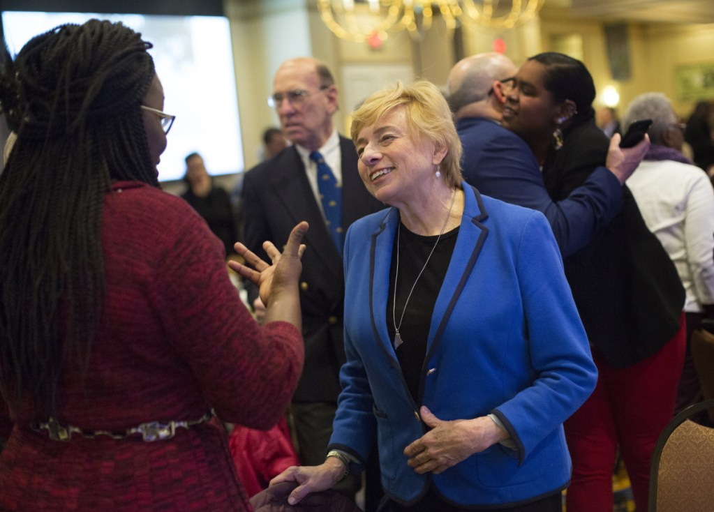 Gov. Janet Mills wears her silver State of Maine necklace at the annual Martin Luther King Jr. Day celebration in Portland this week. After her election last fall, Mills purchased similar pieces for members of her transition team.