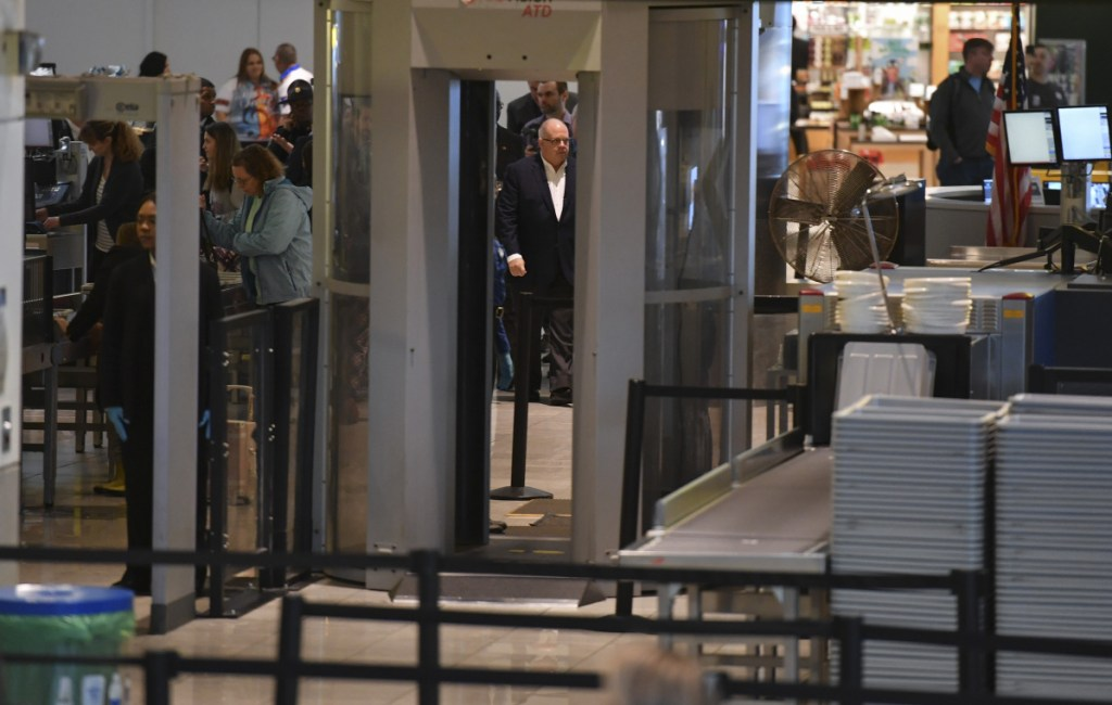 Maryland Gov. Larry Hogan, center, is escorted around the security-screening area on a tour of Baltimore-Washington International Marshall Airport on Thursday, the 34th day of the shutdown. MUST CREDIT: Washington Post photo by Ricky Carioti