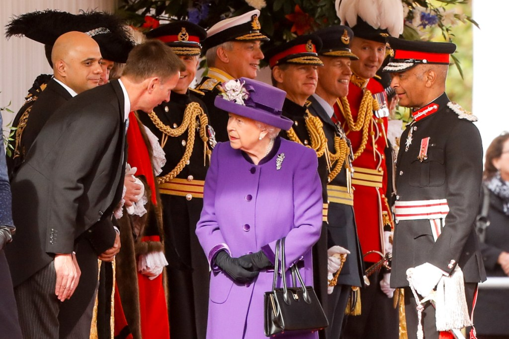 Britain's Queen Elizabeth II  speaks with Jeremy Hunt, British foreign secretary, at an event in London in October.