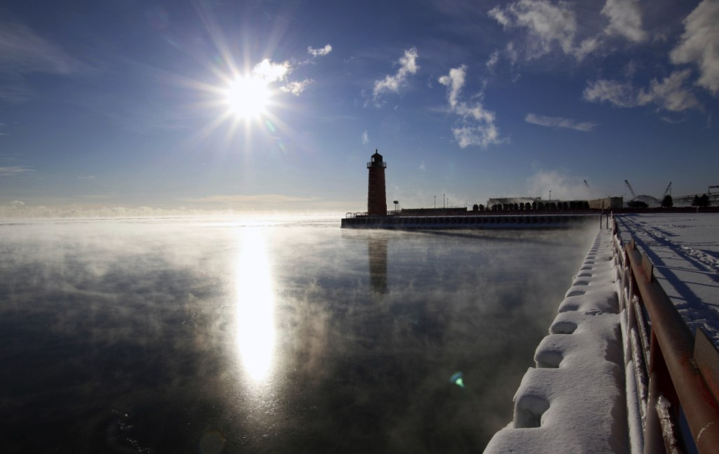 Steam rises from Lake Michigan on Friday morning in Milwaukee. Forecasters say the worst is yet to come, with wind chills as much as 45 below expected in Chicago by the middle of next week.