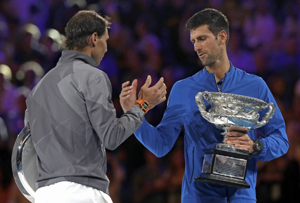 Novak Djokovic, right, shakes hands with Rafael Nadal on the podium Sunday after sweeping to a 6-3, 6-2, 6-3 victory in the Austalian Open final. Now the question is whether anyone is good enough to threaten the two men's tennis leaders.