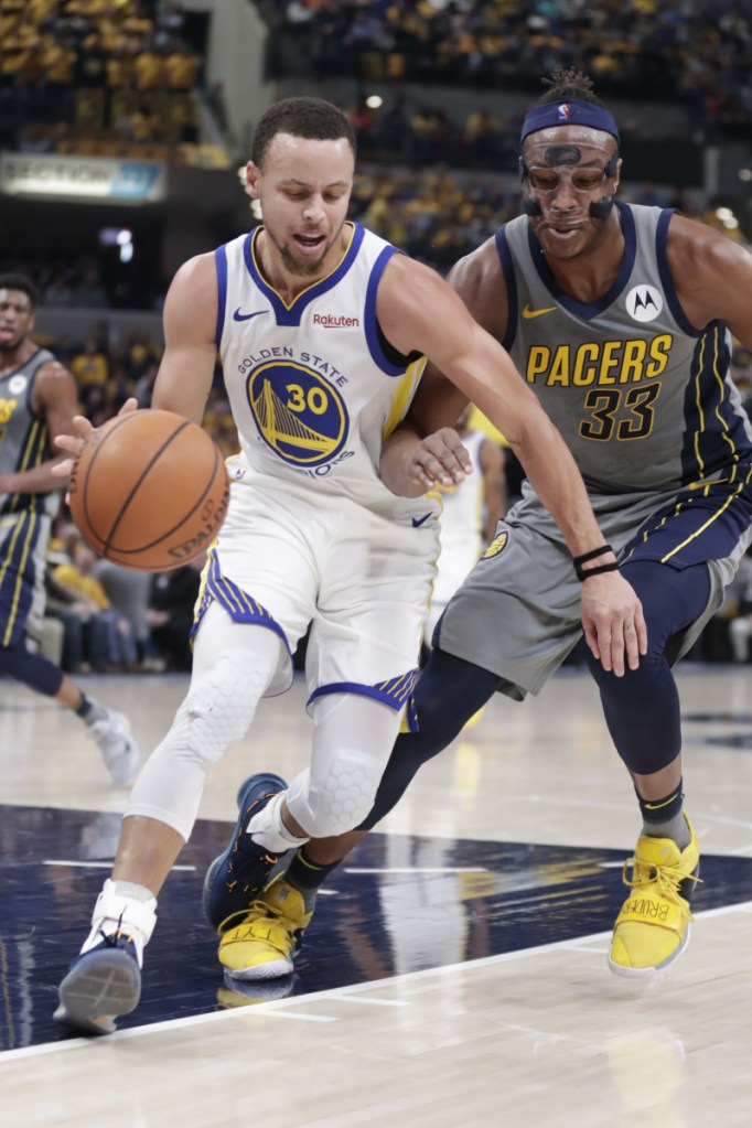 Golden State guard Stephen Curry drives past Indiana center Myles Turner during the first half of the Warriors' 132-110 win Monday in Indianapolis.