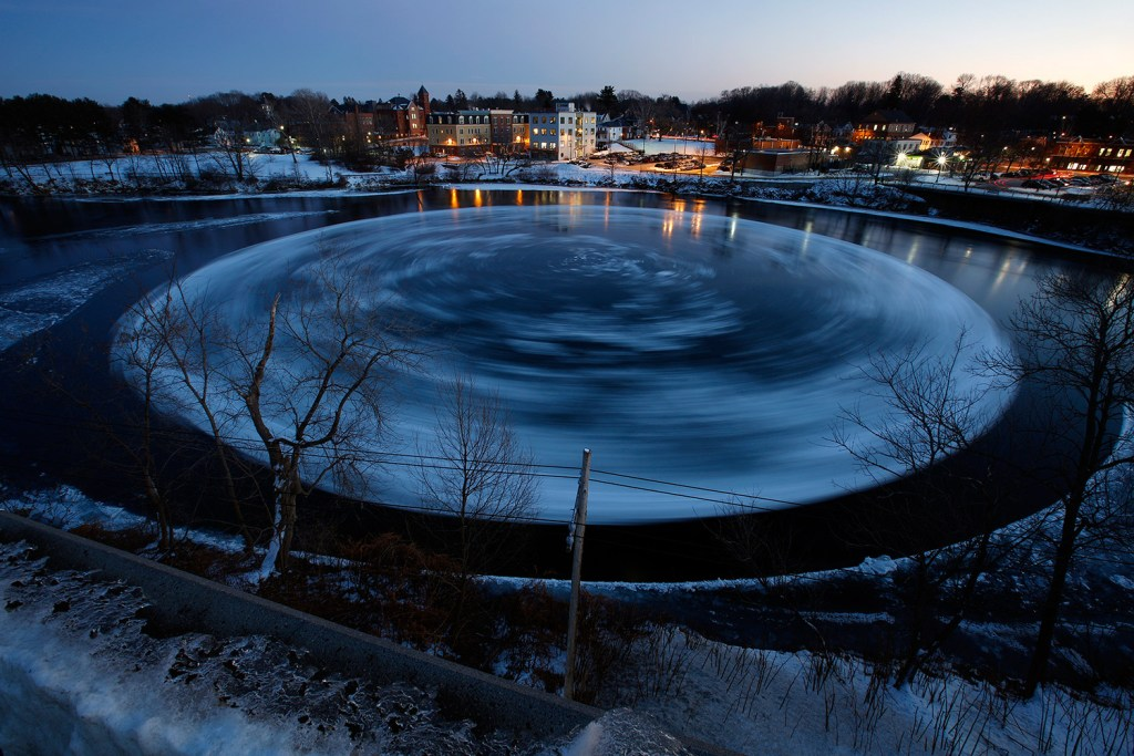 This 30-second exposure shows the circular ice floe spinning counter-clockwise Monday in the Presumpscot River below Bridge Street.