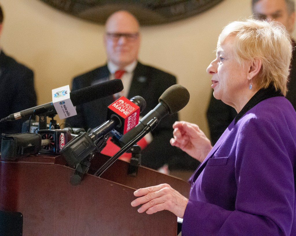 "Gov. Janet Mills speaks at a news conference Tuesday at the State House. She said, ""It is time we build more affordable housing for seniors just as the voters intended."""
