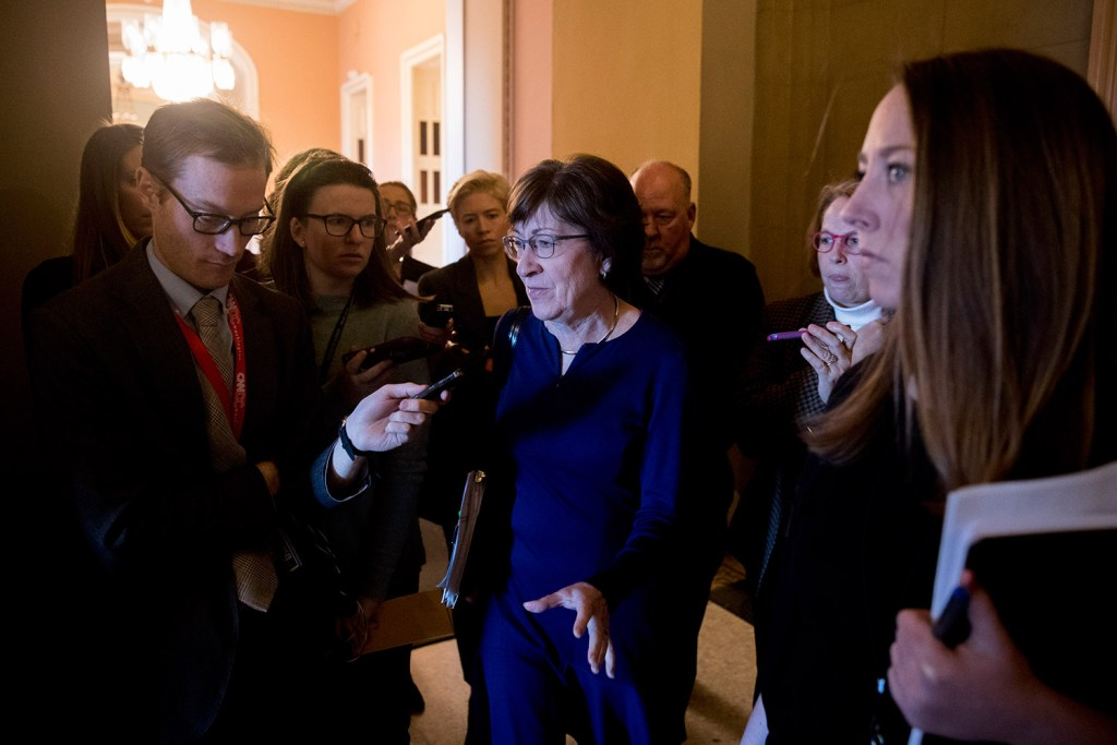 Sen. Susan Collins, R-Maine, speaks to reporters as she walks into the office of Senate Majority Leader Mitch McConnell of Kentucky for a meeting with Senate Republicans on Thursday.