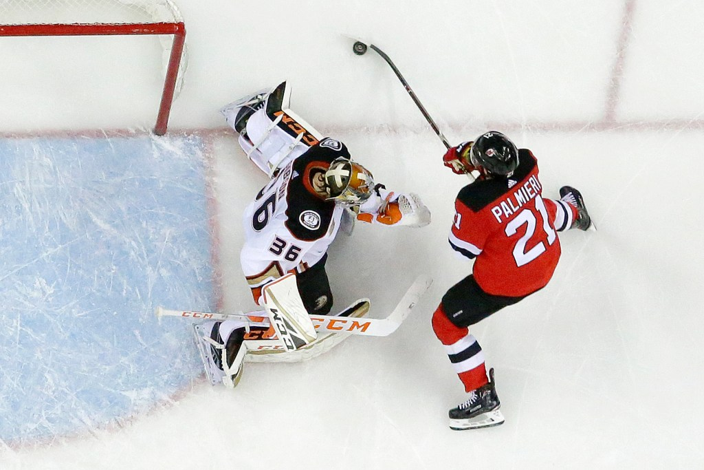 Anaheim Ducks goaltender John Gibson (36) protects his net against New Jersey Devils right wing Kyle Palmieri (21) during the second period of the Ducks' 3-2 win Saturday in Newark, New Jersey.