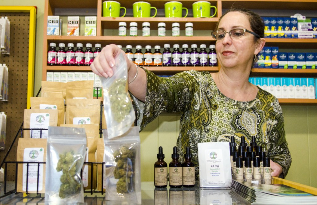 """Catherine Lewis at Homegrown the Offering in downtown Hallowell on Wednesday. She said the provisional license she received from the city is """"the tackiest thing I have ever seen."""""""