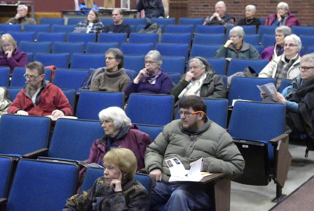 People listen on Sunday to a discussion about the Second Amendment during a forum at the University of Maine at Augusta.