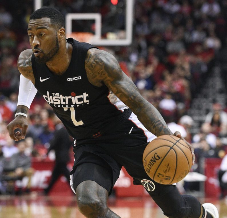 Washington guard John Wall will be sidelined for more than another year because he ruptured his left Achilles tendon after slipping and falling at home.