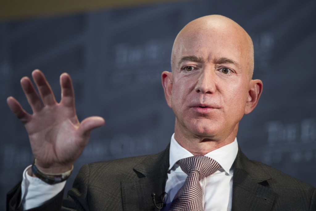Jeff Bezos, Amazon founder and CEO, who also owns The Washington Post, says the National Enquirer threatened to publish revealing photographs of him unless his private investigators backed off the tabloid and Bezos released a statement saying he had no basis for saying the Enquirer's coverage was politically motivated.