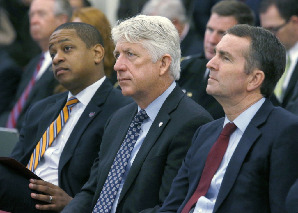 From left, Lt. Governor-elect Justin Fairfax, Attorney General-elect Mark Herring and Governor-elect Ralph Northam listen as Virginia Governor Terry McAuliffe addresses a joint meeting of the House and Senate appropriations committees in Richmond, Va., in 2017. With Virginia's top three elected officials engulfed in scandal, fellow Democrats were rendered practically speechless, uncertain of how to thread their way through the racial and sexual allegations and their tangled political implications.