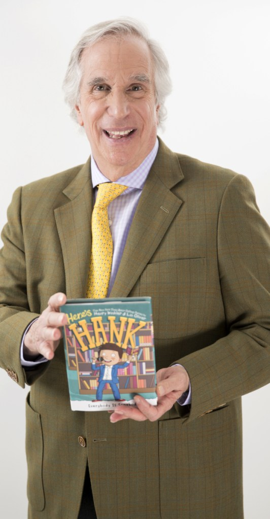 "Actor and author Henry Winkler holds his latest book in the ""Here's Hank"" series."