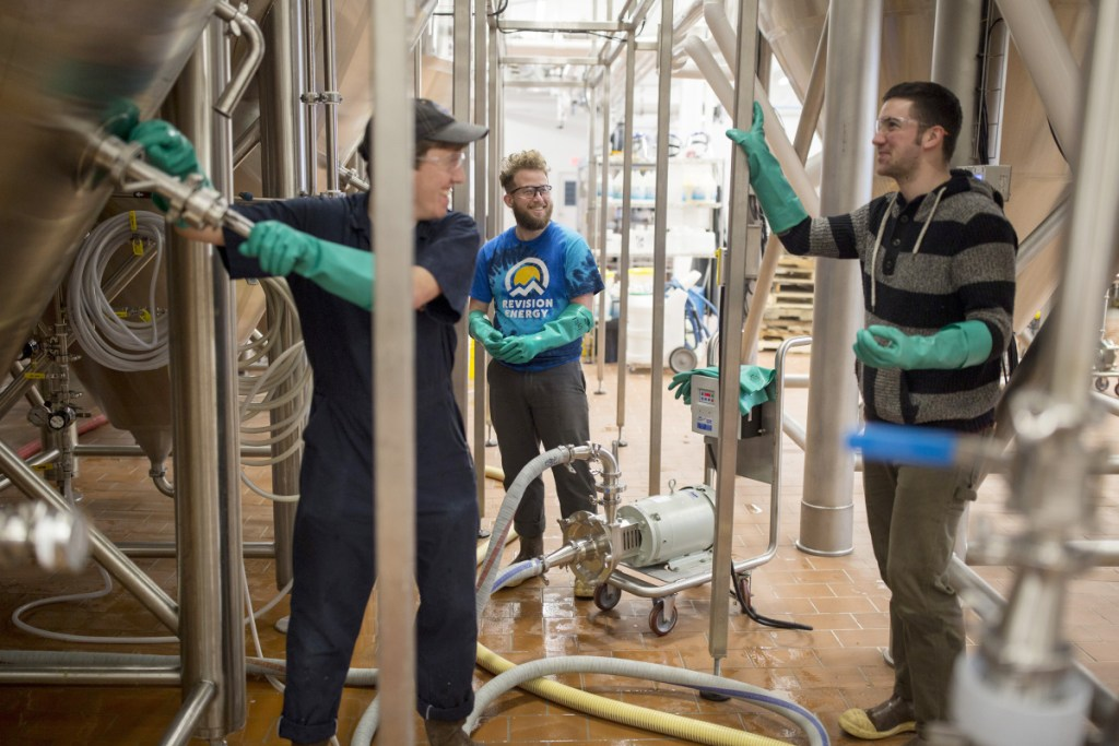 "Maine Beer Company employees, from left, Phil Neil, Seth Gill and David Love all have paid sick days as part of their benefits at the Freeport brewery. The company, which employs about 50 full-timers, believes paid sick leave is ""good for business,"" said co-owner Dan Kleban, ""because workers are more productive if they're not coming to work sick."""