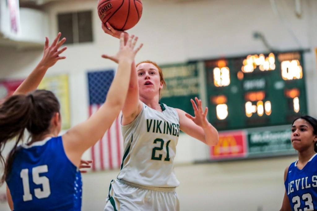 Julia Colby of Oxford Hills drives for a basket during a Class AA North quarterfinal Tuesday night against Lewiston. Top-seeded Oxford Hills cruised to a 77-26 win.