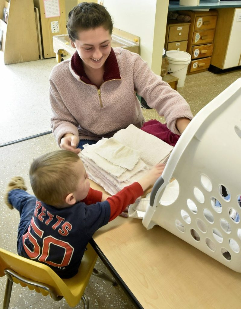 University of Maine at Farmington student Lexi Lettre works with a young boy named Andrew at the Sweatt-Winter Child Care and Early Education Center on Tuesday morning. The on-campus program will be moving into another nearby building by the end of summer.