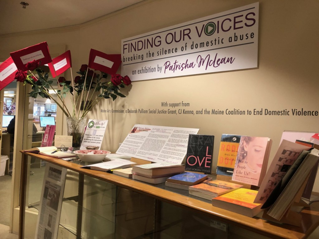 "The exhibit includes ""Red Flags"" placed among long-stemmed red roses to alert girls and women to keep their eyes open amid the trappings of romance. Sue White, a seamstress in Camden, sewed the red flags. Each flag has a relationship warning such as ""Lies,"" ""Isolates you,"" ""Has no friends and is estranged from family members"" and ""Sweeps you off your feet."""
