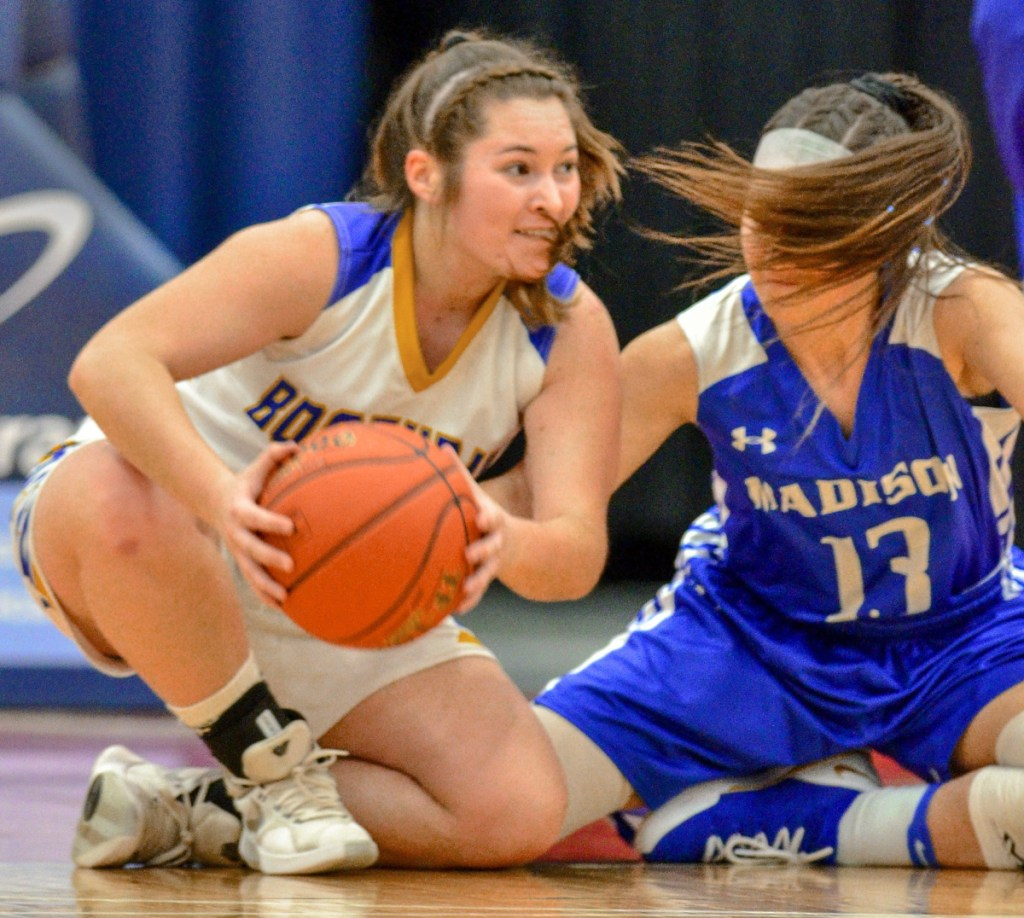 Boothbay's Madison Faulkingham beats Emily Edgerly of Madison to a loose ball during their Class C South semifinal Thursday at the Augusta Civic Center. Boothbay won, 55-23.
