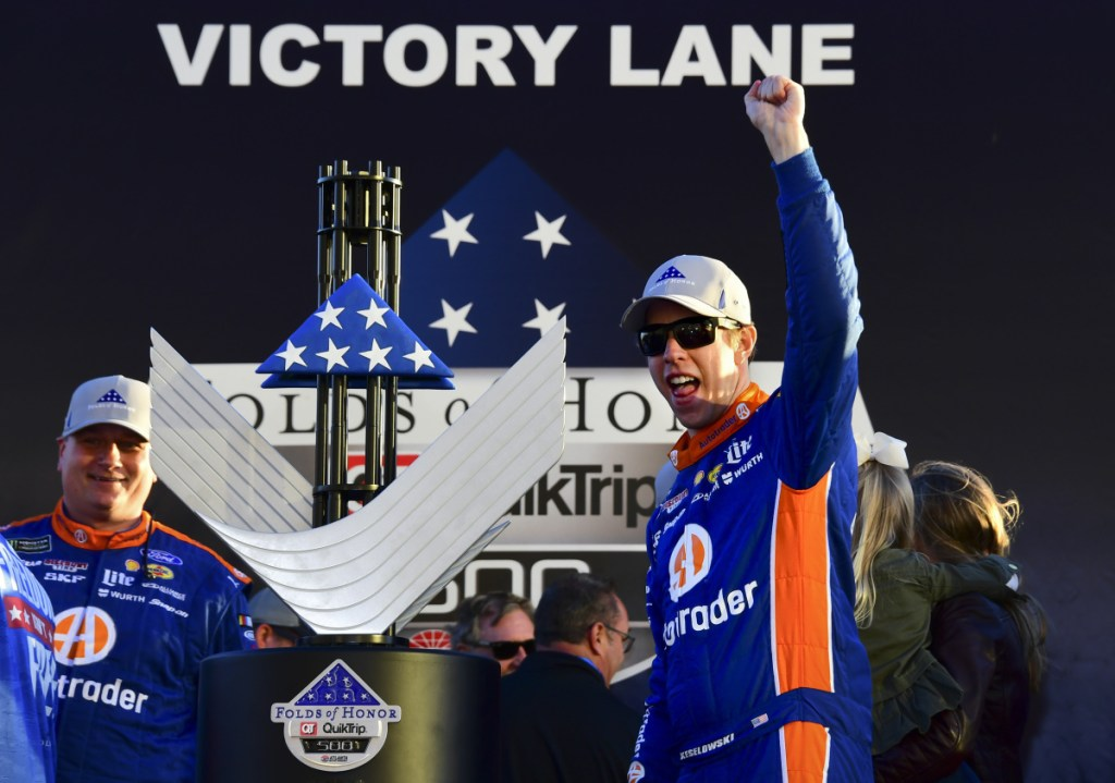 Brad Keselowski, right, celebrates in Victory Lane after winning the NASCAR Cup Series race Sunday at Atlanta Motor Speedway in Hampton, Ga. Keselowski overcame a stomach virus to capture his 60th Team Penske victory.
