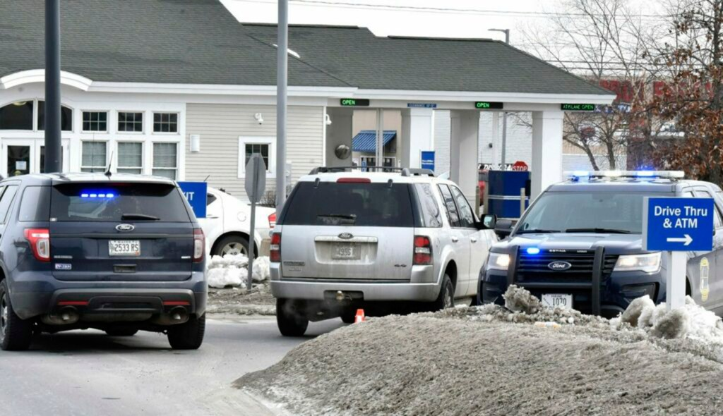 Three police vehicles block the entrance to the Bangor Savings Bank on Waterville Commons Drive in Waterville after a robbery on Tuesday morning.