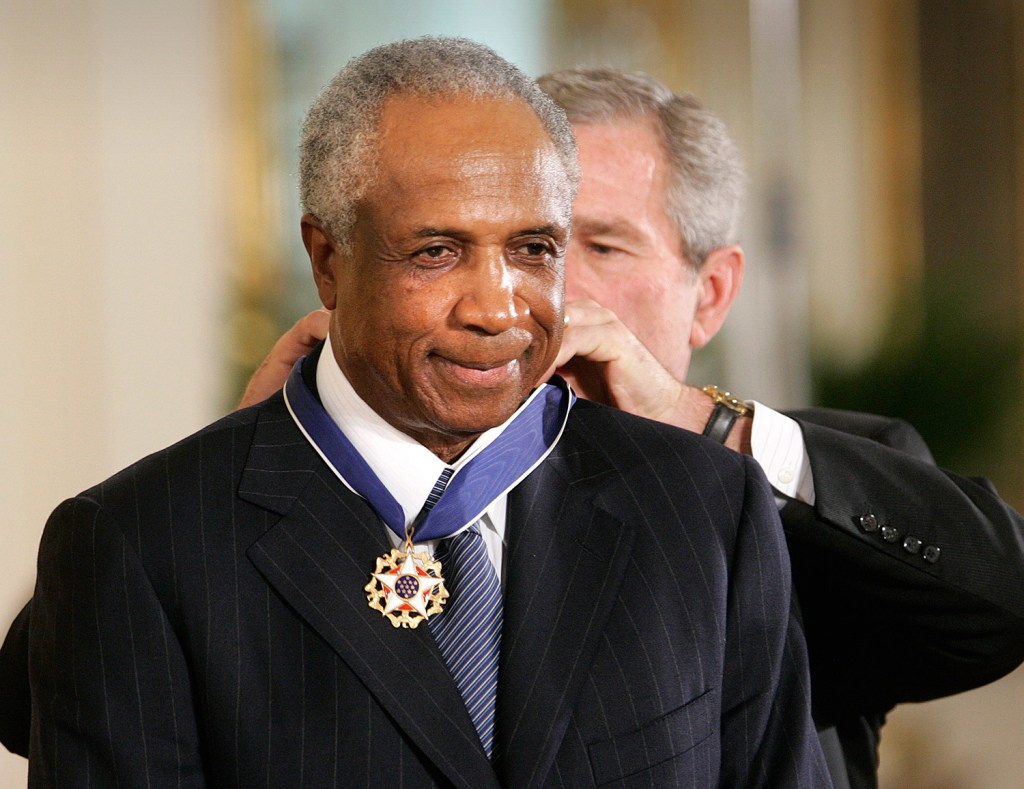 President George W. Bush gives Frank Robinson the Presidential Medal of Freedom Award at the White House on Nov. 9, 2005.