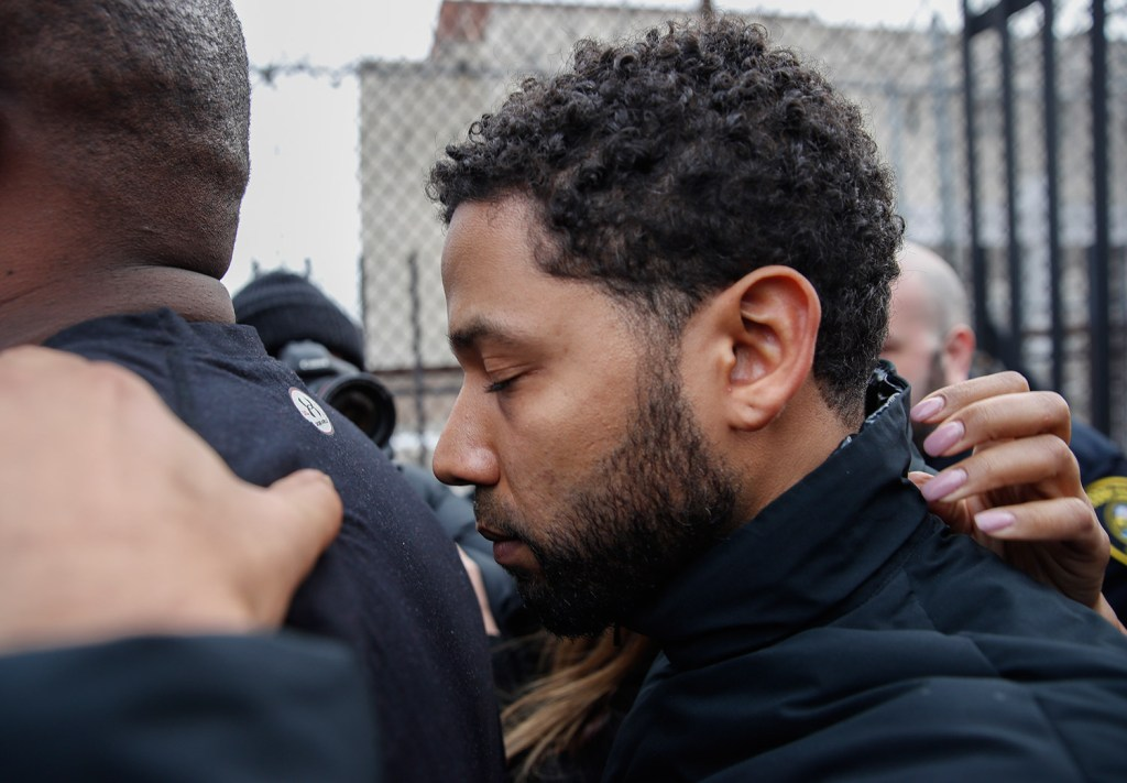 """""""Empire"""" actor Jussie Smollett leaves the Cook County jail after his release Thursday in Chicago. Smollett was charged with disorderly conduct and filling a false police report for saying he was attacked in downtown Chicago by two men who hurled racist and anti-gay slurs and looped a rope around his neck."""